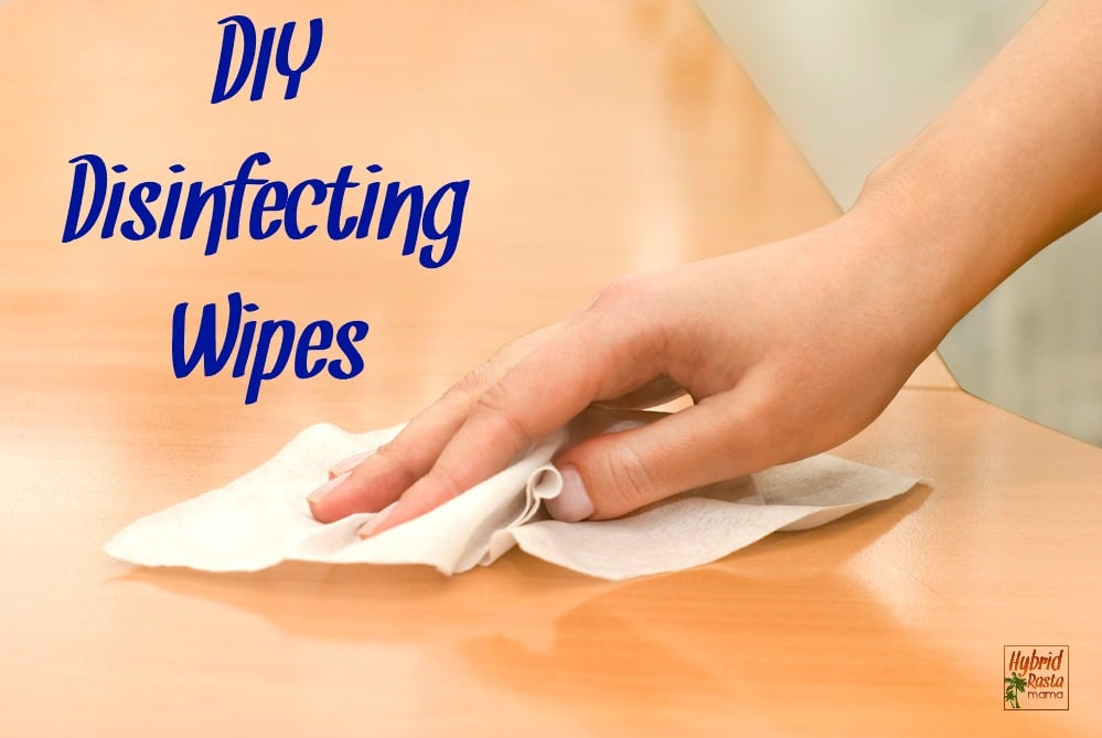 hand with DIY disinfecting wipes cleaning table